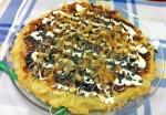 Añadimos los copos katsuobushi al Okonomiyaki
